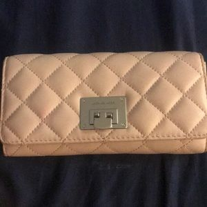 Micheal Korea's wallet is blush pink. It's new.